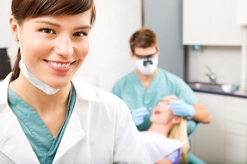 female hygienist in the foreground